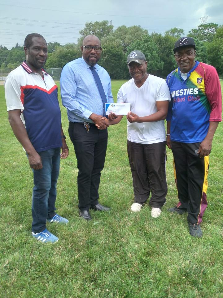 EDCL Vice Chairman Douglas James receives sponsorship from Claude Thompson of JN Money Services (Canada) Limited on behalf of Westies C.C.