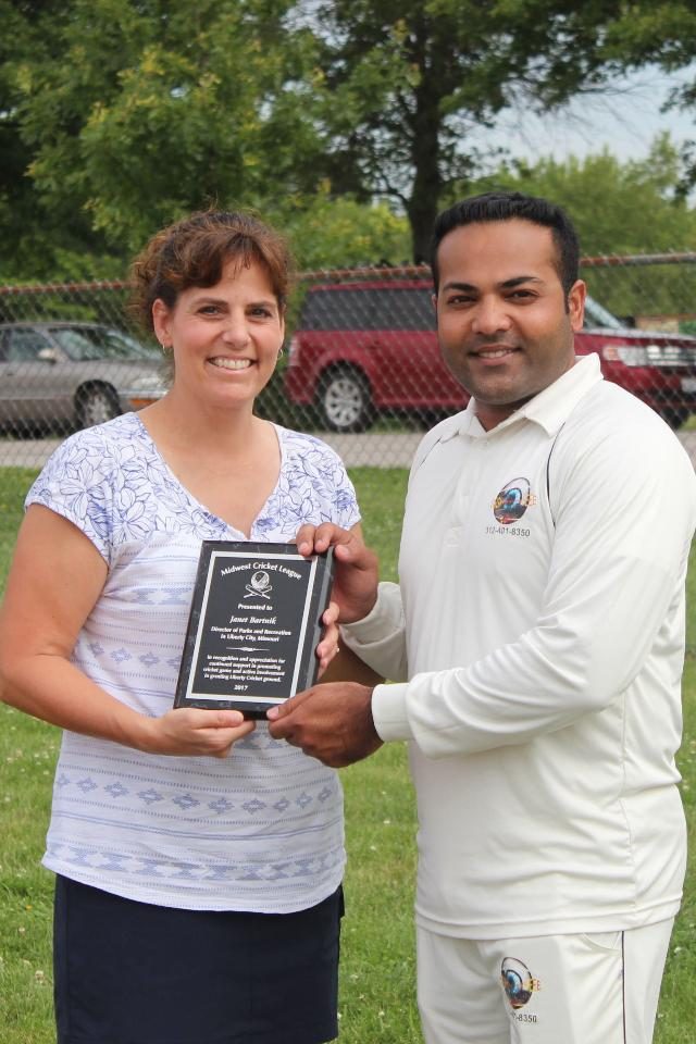 Janet receiving appreciation plaque by MWCL President Sohail Anwar