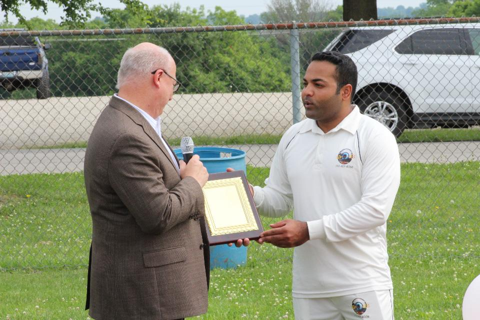 Mayor Brenton receiving a Appreciation Gold Plaque by MWCL President Sohail